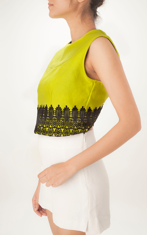 GREEN VEST   This smart high neck vest is versatile and can be styled in many ways. With an open back and lace detailing, this piece is made from 100% Linen and lined with cotton.  Dry cleaning is recommended.   Code : 003GV