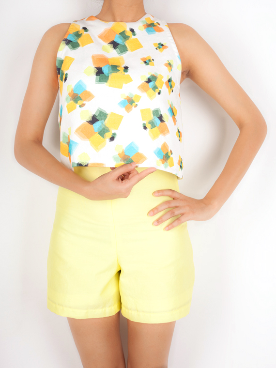 PLAYSUIT   This fun piece is perfect for the summer! The 'Geometric Butterflies' print dawns the front and portions of the back. The lemon yellow bottom enhances the aesthetic of the print, and completes the piece. Made from 100% Cotton Linen and Twill.  Code : 0012JPSY