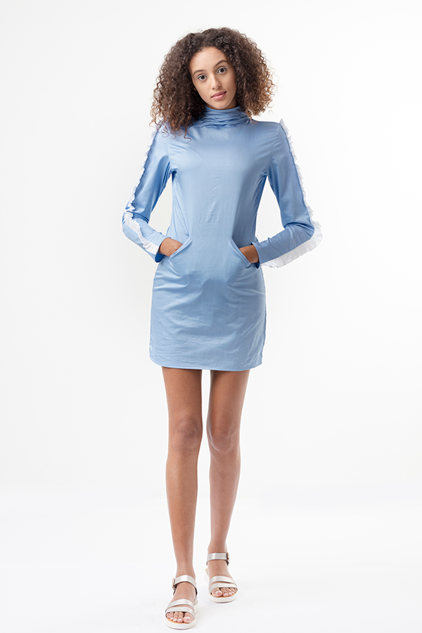 LUNA MINI DRESS   A super cute mini dress with a twist! This powder blue mini has long sleeves with a fun ruffle detail all along. It has a high neck with a pleating detail on one side. There is an invisible zipper at the back, along with welt pockets in the front. The cotton fabric has a satin weave which lends a bit of shine to the garment.                                 Dry Clean Only.    Size :  S, M, L, XL, C  Code :  0095BD