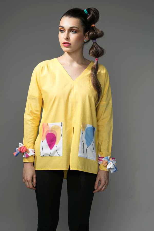 YELLOW SHIRT   A lovely yellow shirt, apt for all seasons. This piece has a dropped shoulder, with long sleeves and a tie up cuff. The cuffs and pockets are in the 'Fly Away Balloon' print, giving it just the right amount of quirk. The shirt is made from 100% cotton. Hand wash in cool water.   Size :  S, M, L, XL, C  Code :  0068HLS