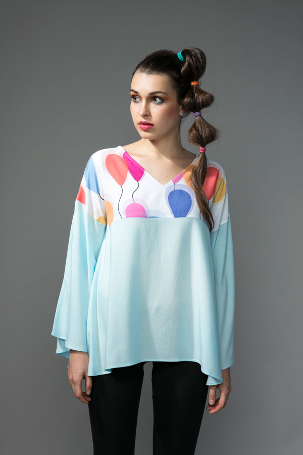 CAPE TOP   Light and airy, this cape top is a great way to beat the heat in style. The V neck yoke is made from modal in our 'Fly Away Balloon' print and the body is made from cool blue rayon. A fabric that is light, breathe-able and oh so comfortable! Hand wash in cool water.   Size :  S-M, L,-XL  Code :  00569CT