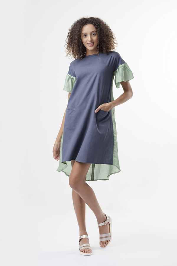 JADE DRESS  Comfortably cut, this tent dress has single welt pockets in the front. The back is made from satin linen and has fabric buttons which serve as a closure. It has a dropped shoulder which ends in a ruffle sleeve. The front panel is made from cotton fabric.  Dry Clean Only.           Size :  S, M, L, XL, C  Code :  0081TDP