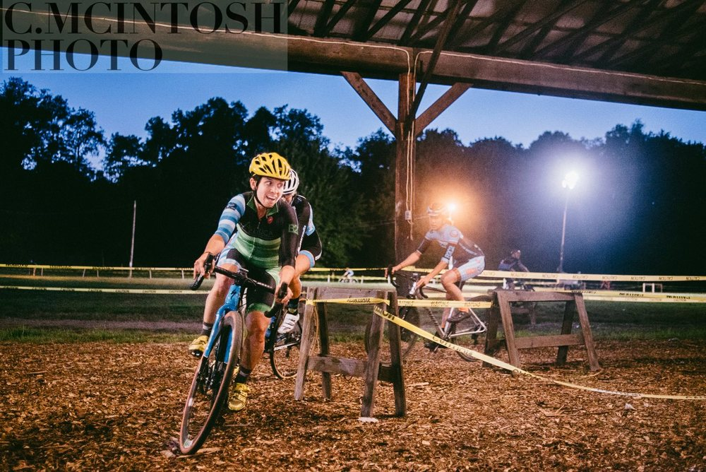 Erin leads a group through the tricky woodchips at Midnight CX. Photo Credit to the wonderful Chris McIntosh.