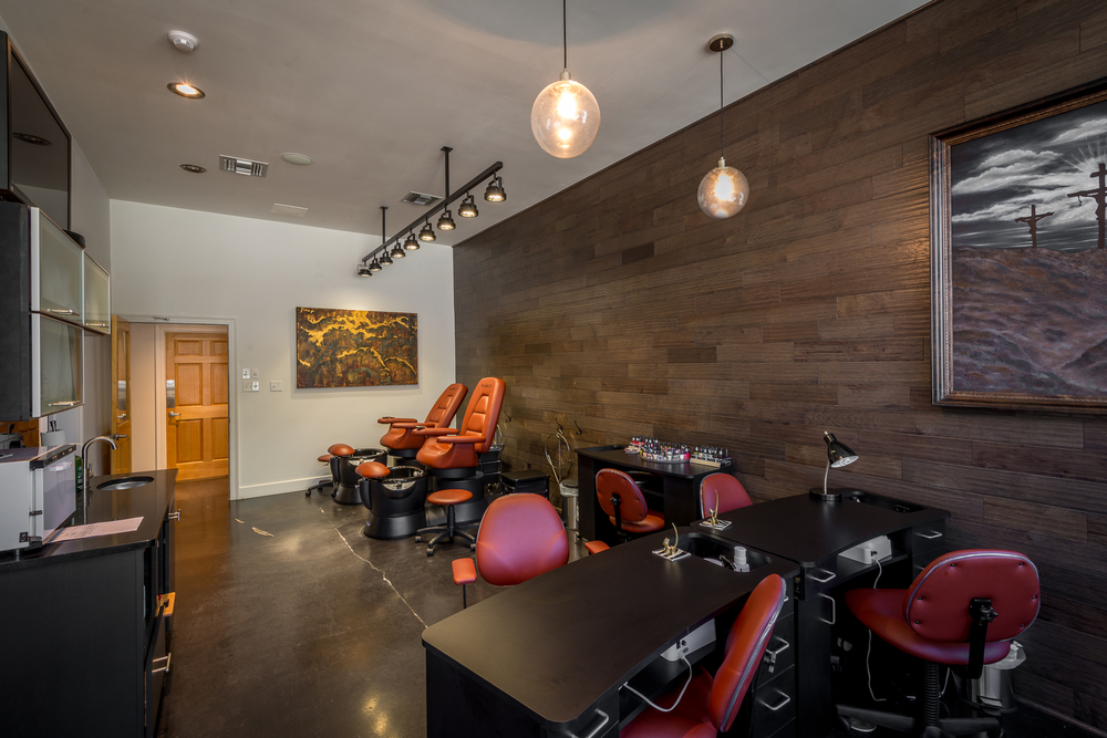 "The Salon Rubicon  Houma, LA - Manicure/Pedicure Stations JBL Pro in-ceiling speakers and a Panasonic 42"" HD plasma monitor blend seamlessly into this area's decor."