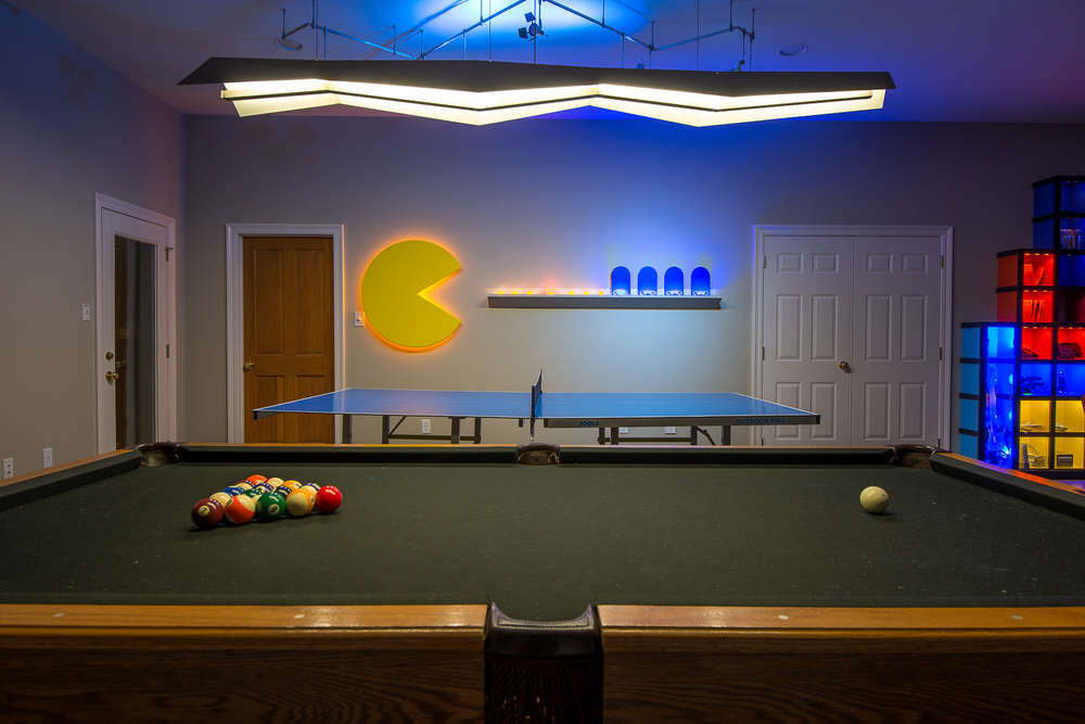 "The ""Pac-Man Wall"" was designed to house all of the ping-pong balls and paddles."