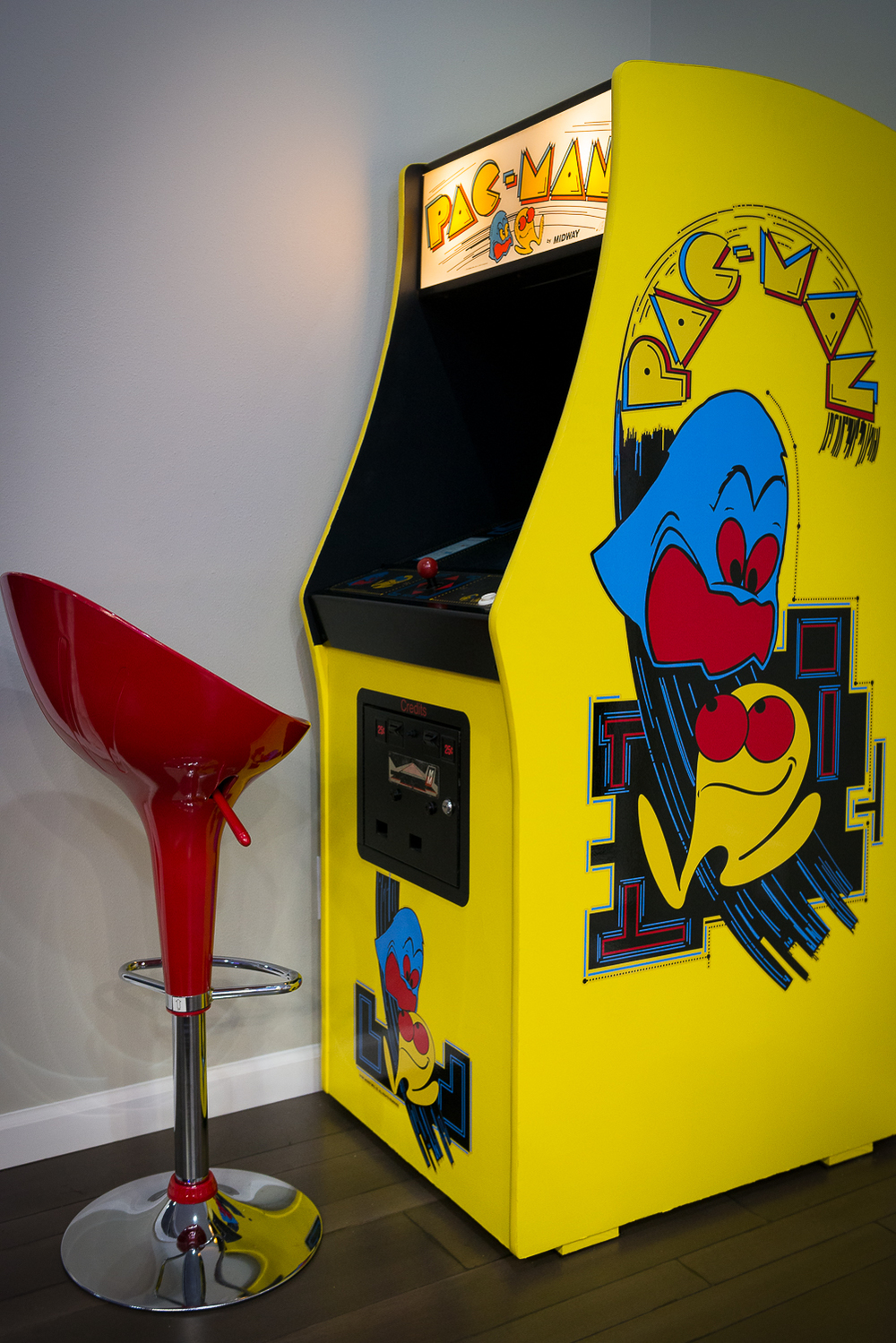 The room's vintage Midway Pac-Man machine was beautifully restored by Josh Hebert of Marlin Construction.