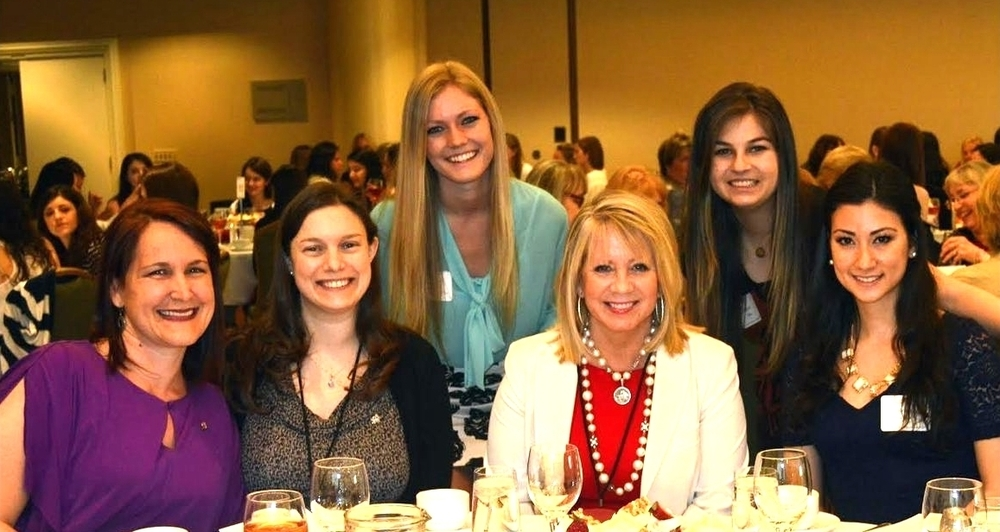 Collegiate members pose with alumnae and former Alpha Phi International President, Linda Boland, at our 125th Anniversary Celebration Luncheon.