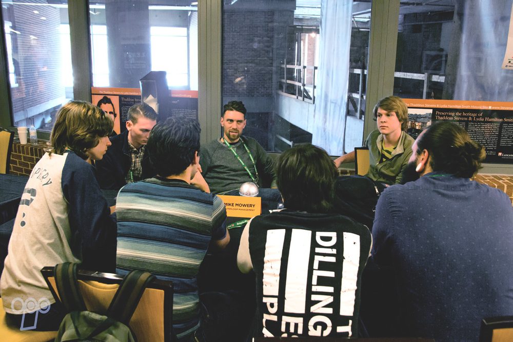 Mike Mowery, CEO of Outerloop Management & Outerloop Records, speaking with a band during LAUNCH's Mentoring session.