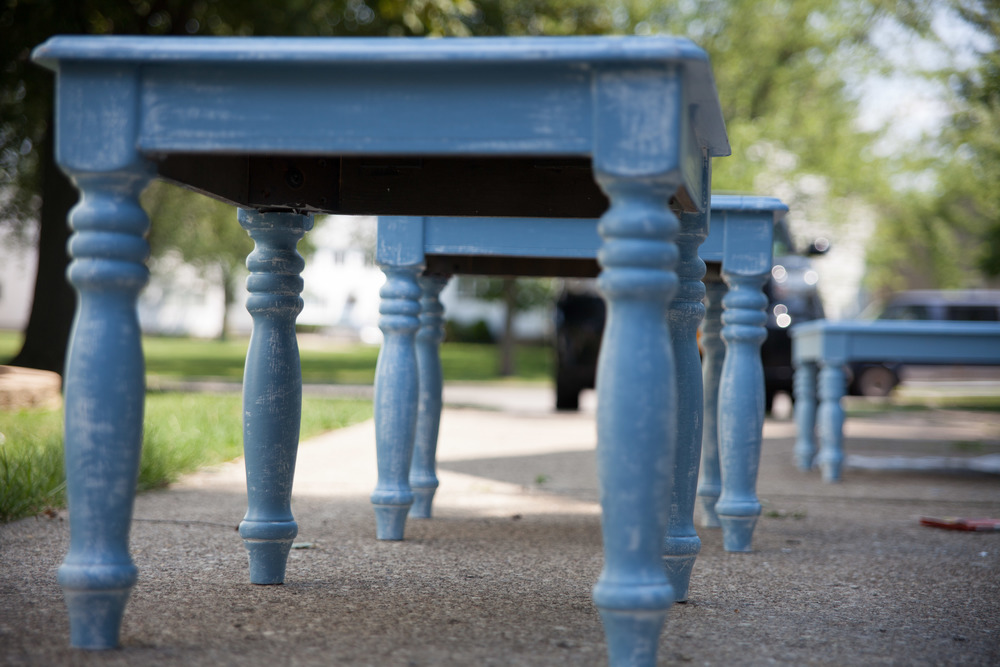I loved the blue but I started to feel like I wanted the blue to really stand out. I took a can of glossy black paint and did the legs of both of the end tables.