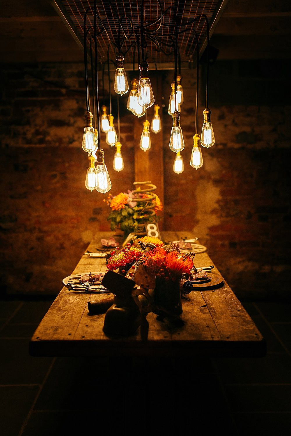 edgy warehouse wedding table scape alternative wedding photographer