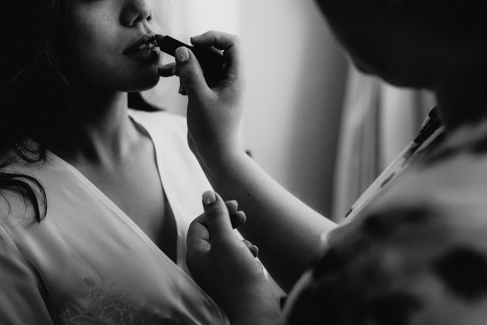 black and white candid bride getting ready sandrock farm