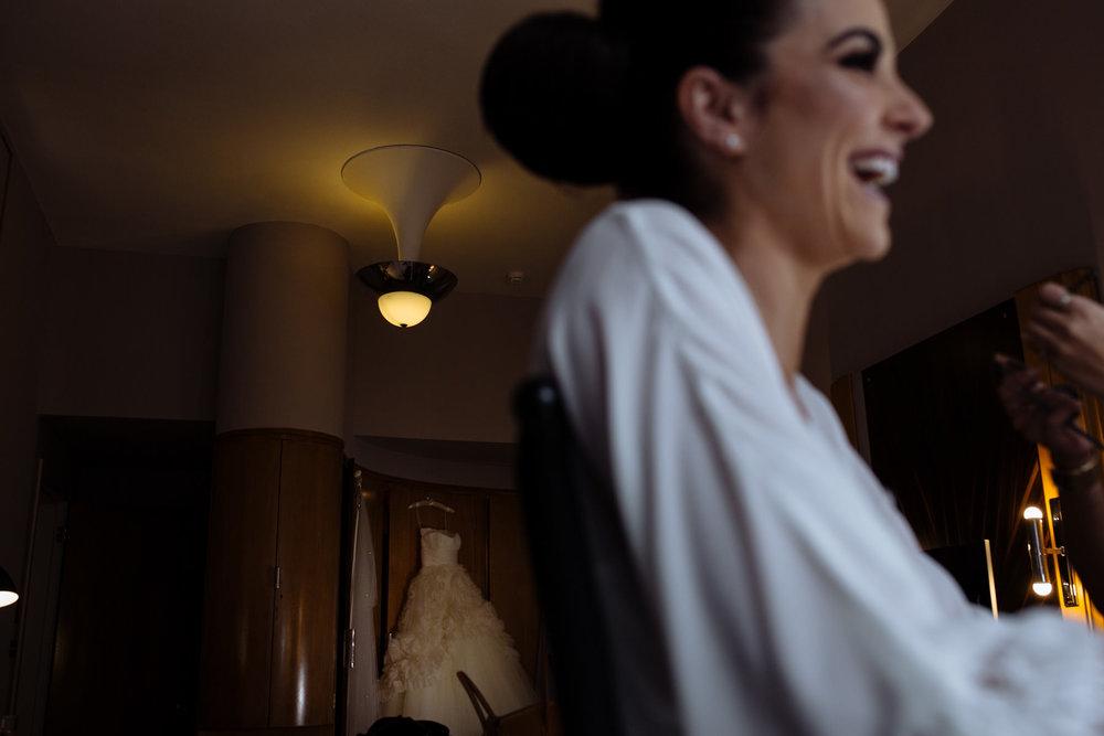 bride getting reading documentary claridges wedding photography