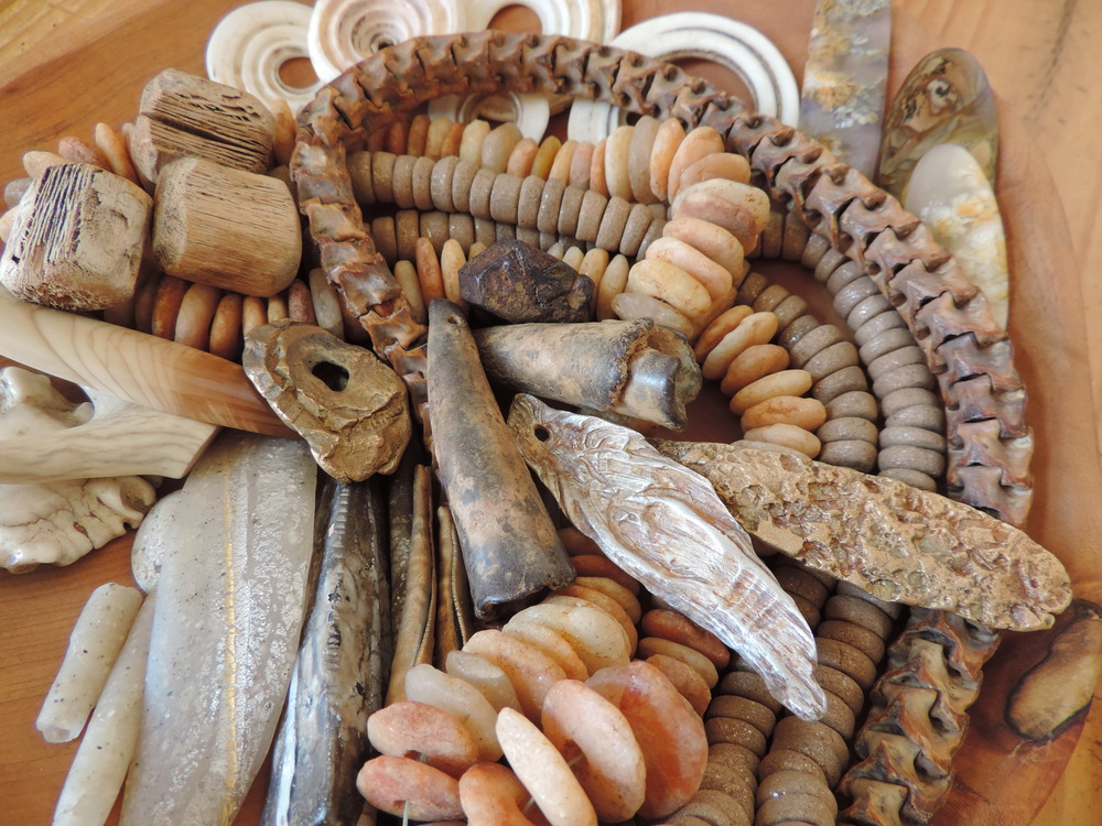 Favorite components of silver and bronze metal clay, polymer artifacts, ancient stone, snakebones, Taos clay, saguaro rib beads, and more.