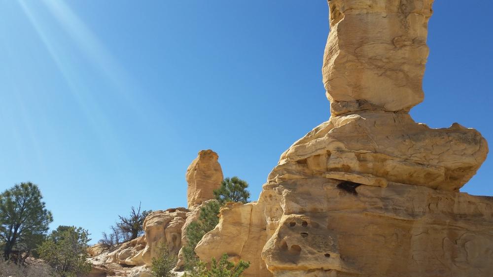 Sandstone hoodoos tower overhead.