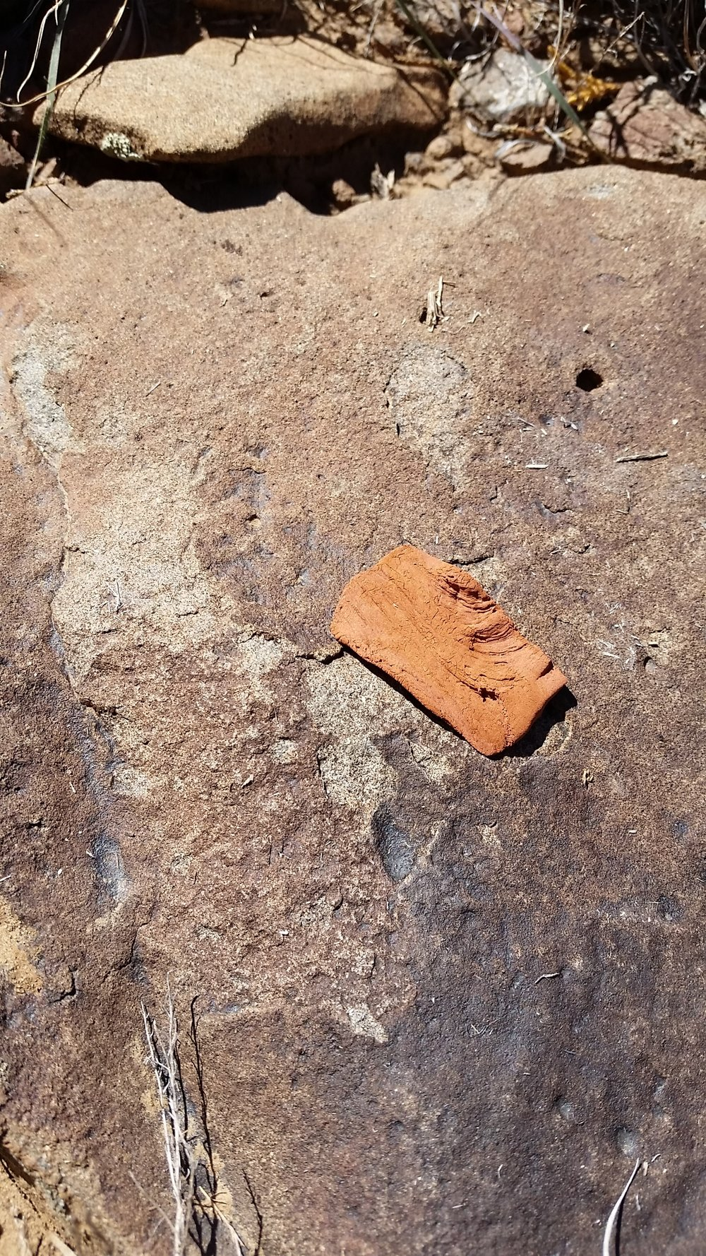 The first copper clay element from the juniper, drying on a boulder in the sun.