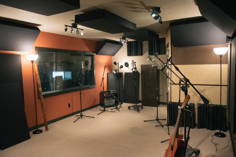 "Here is our tracking room. We have it setup in our ""mic stations"" configuration here. This is where you move from mic to mic throughout your performance."