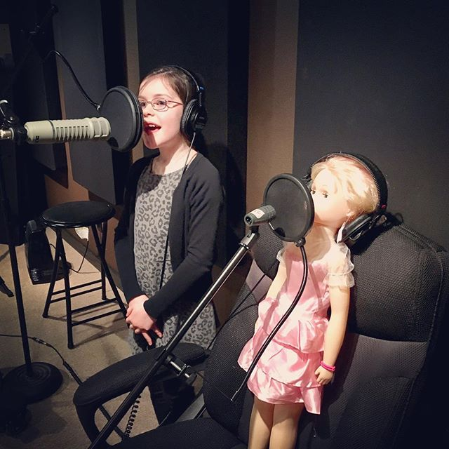 8 yr old Ava doing a photoshoot with her doll, who also recorded her own song. #lovemyjob