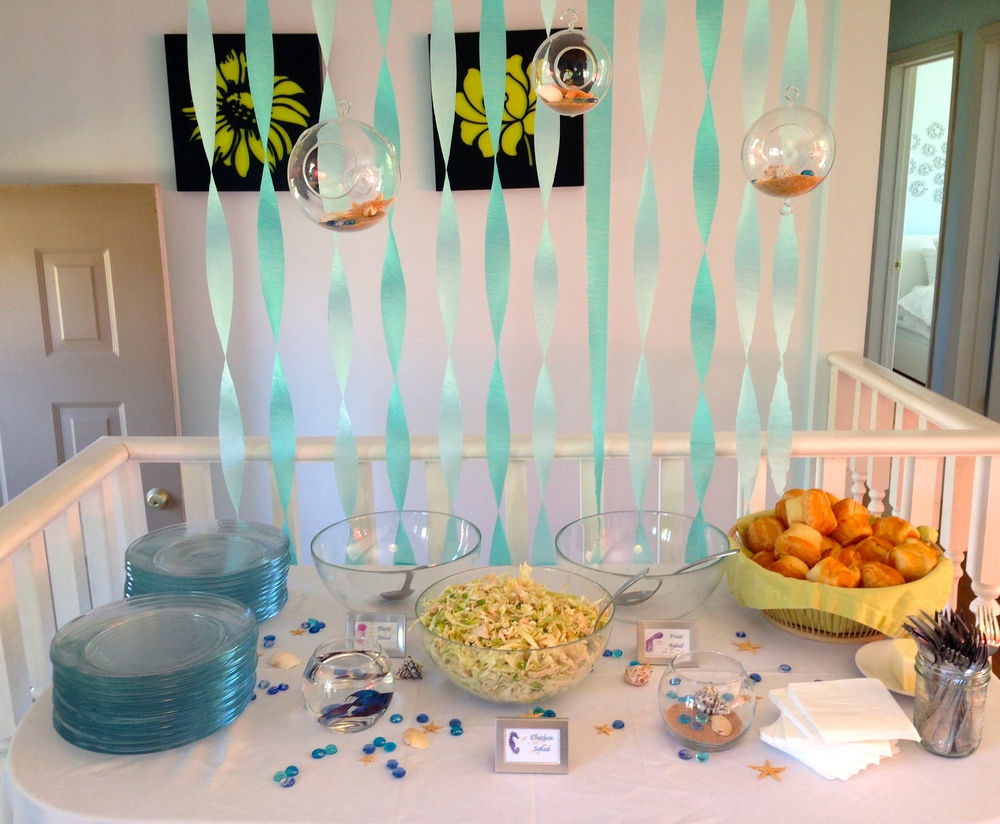 food table with dollar tree glass plates and ikea bowls chicken salad