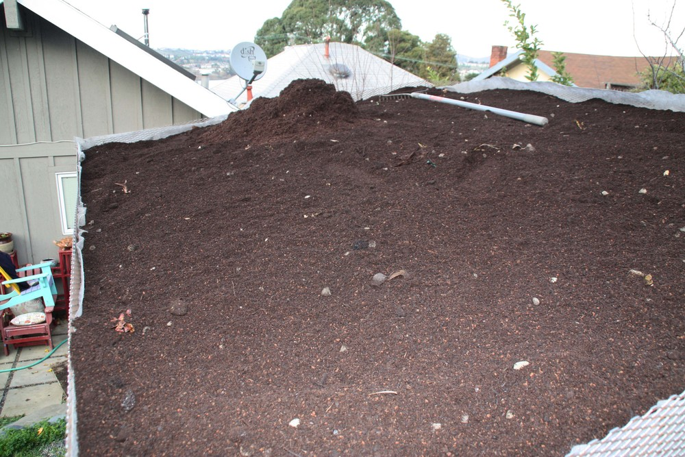 A lightweight soil is placed over the filter fabric.