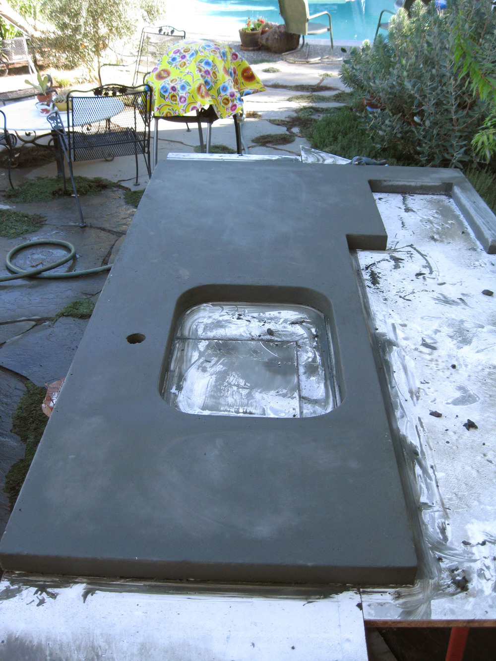 After curing, the concrete counter tops are taken out of the molds and flipped over so that the face poured against the melamine is exposed.