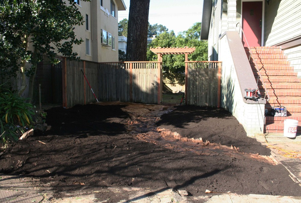 A layer of organic compost is then spread over the cardboard.