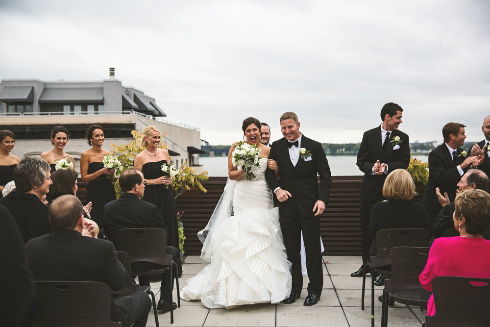 """Anna Kristin & John    Anna Kristin and John said """"I do"""" on the beautiful rooftop of the 21c Museum and Hotel in downtown Louisville. During the reception, guests were invited to enjoy the Museum's art galleries and treated to a delicious dinner by Proof on Main. Their vision of modern and classy come to life through succulents and garden roses!"""