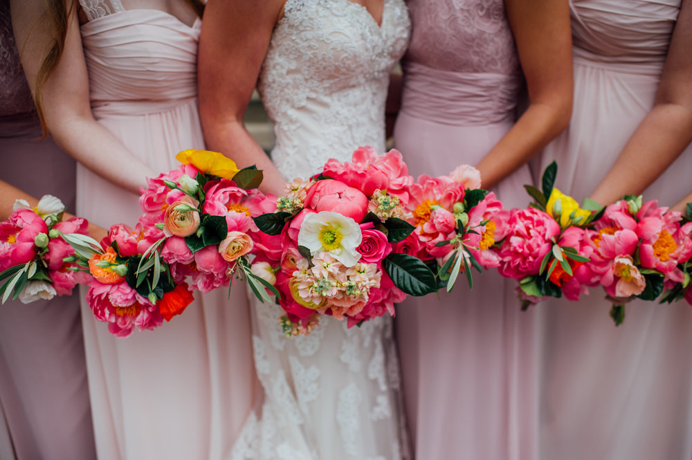 Alexandrea & Vincent    Color, color, color! We went bright and bold with this sweet wedding. Their reception at Muhammad Ali center held spectacular views of our great city and the Ohio river. We loved
