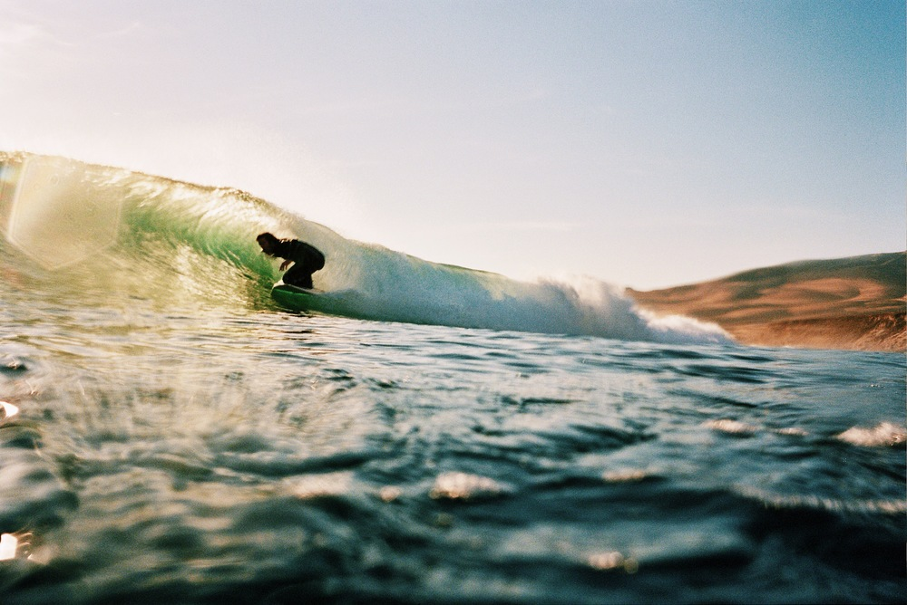 Co-founder Nathan Garrison surfing on California's central coast