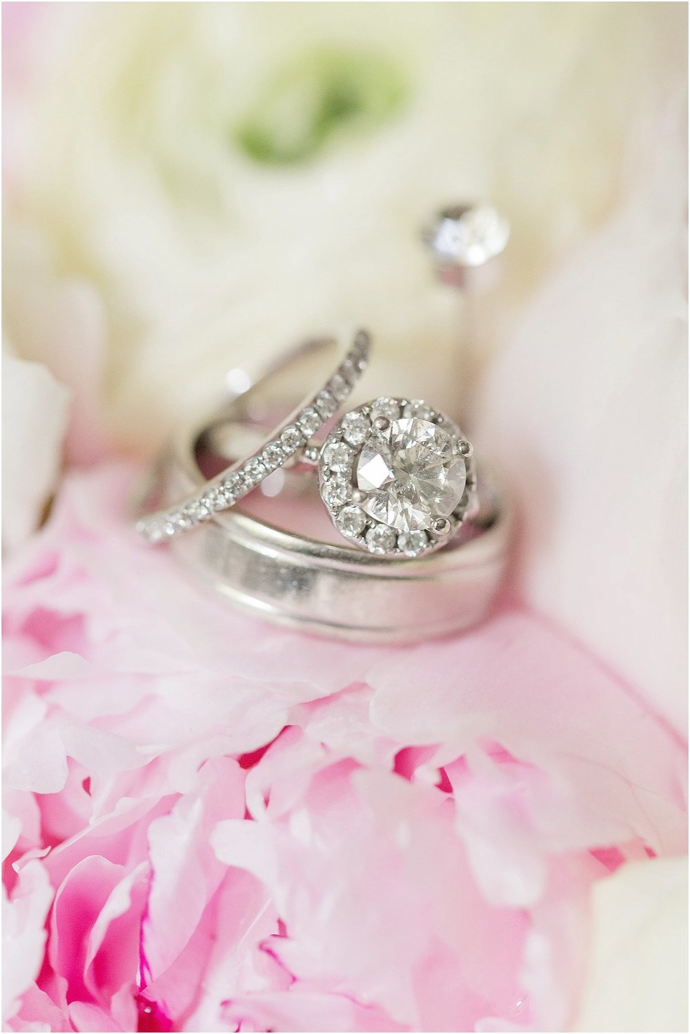 Wedding Bands and halo engagement ring on peony bouquet
