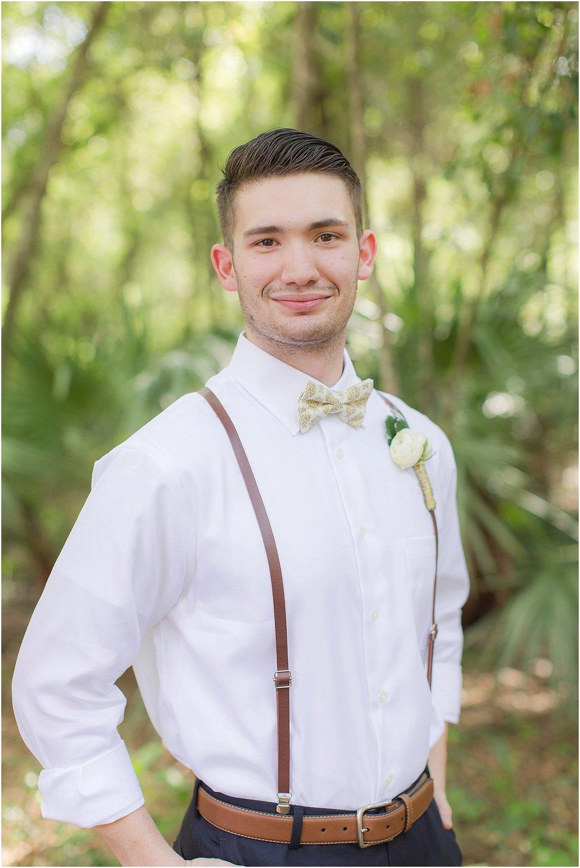 Dapper groom in rustic wedding in Central FL