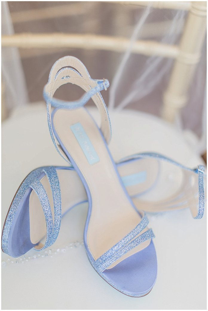 Her something blue.  Blue wedding shoes by Betsey Johnson.