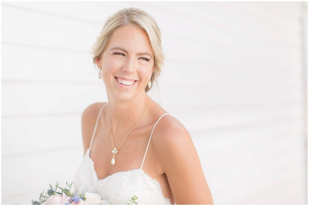 Classic bridal portraits with summer gown and low bun
