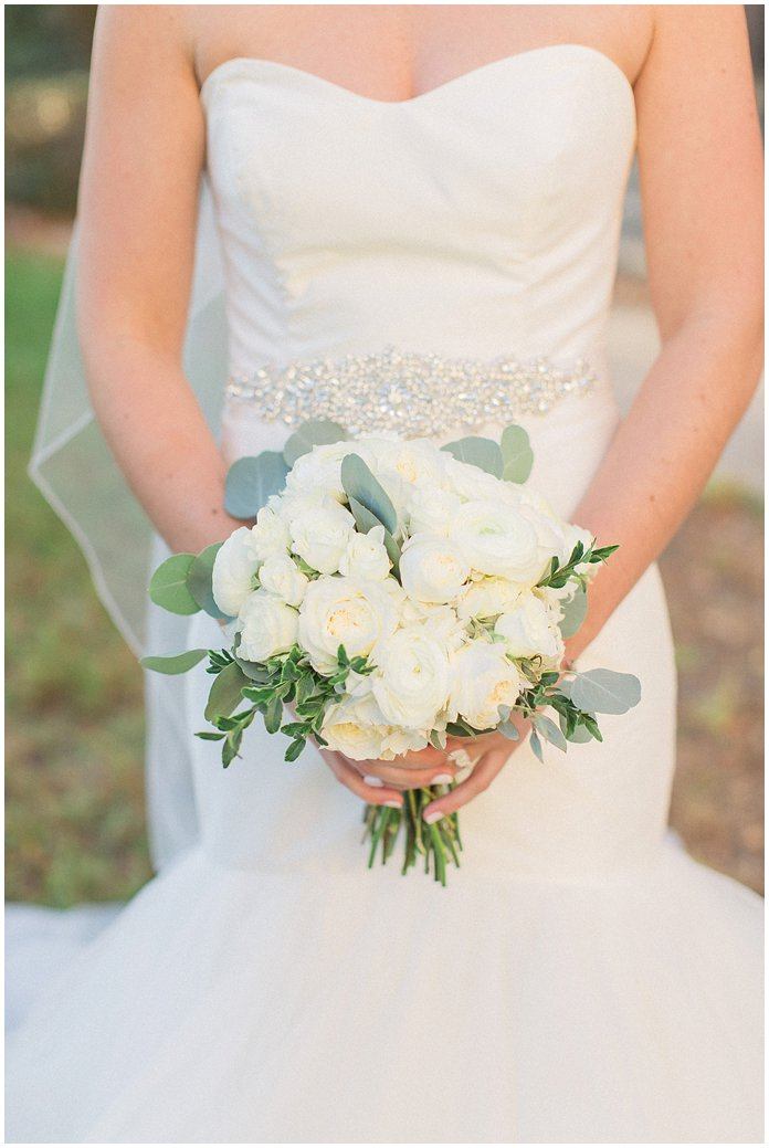Gorgeous all white bridal bouquet of ranunculus and peonies.