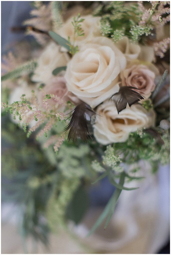 Organic mauve colored rose bridal bouquet with astilbes and garden roses