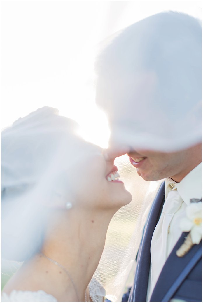 That Smile!  Bride and Groom Portrait with Romantic Veil