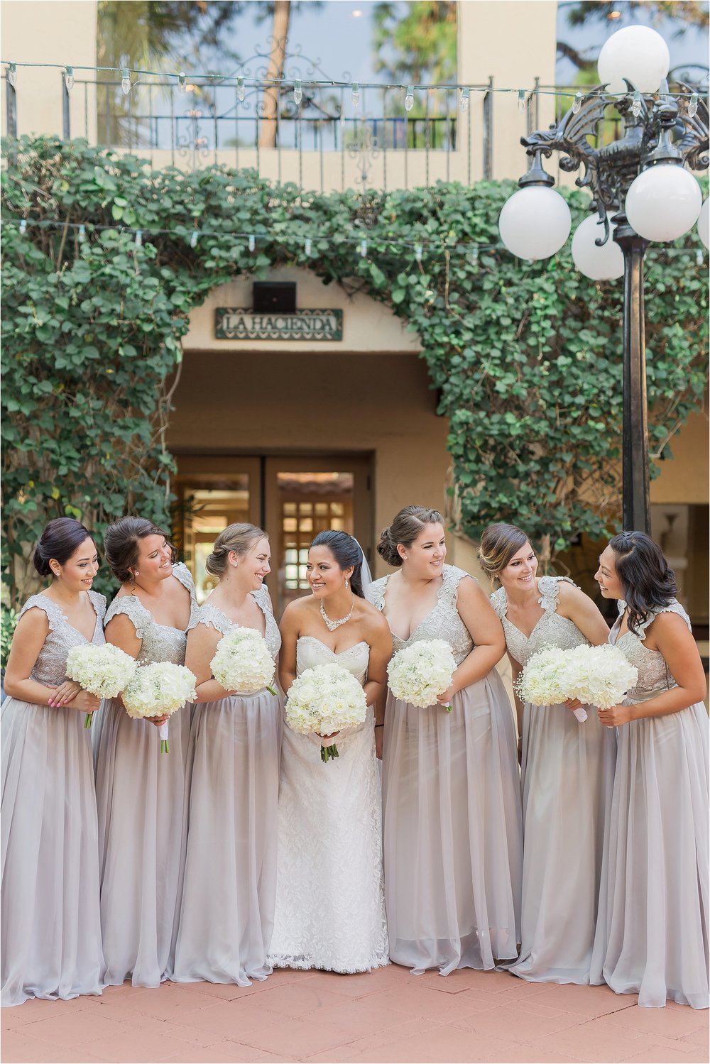 Gorgeous Light Grey Bridal Party with White Florals of Hydrangea and Bridal Bouquet of White Roses