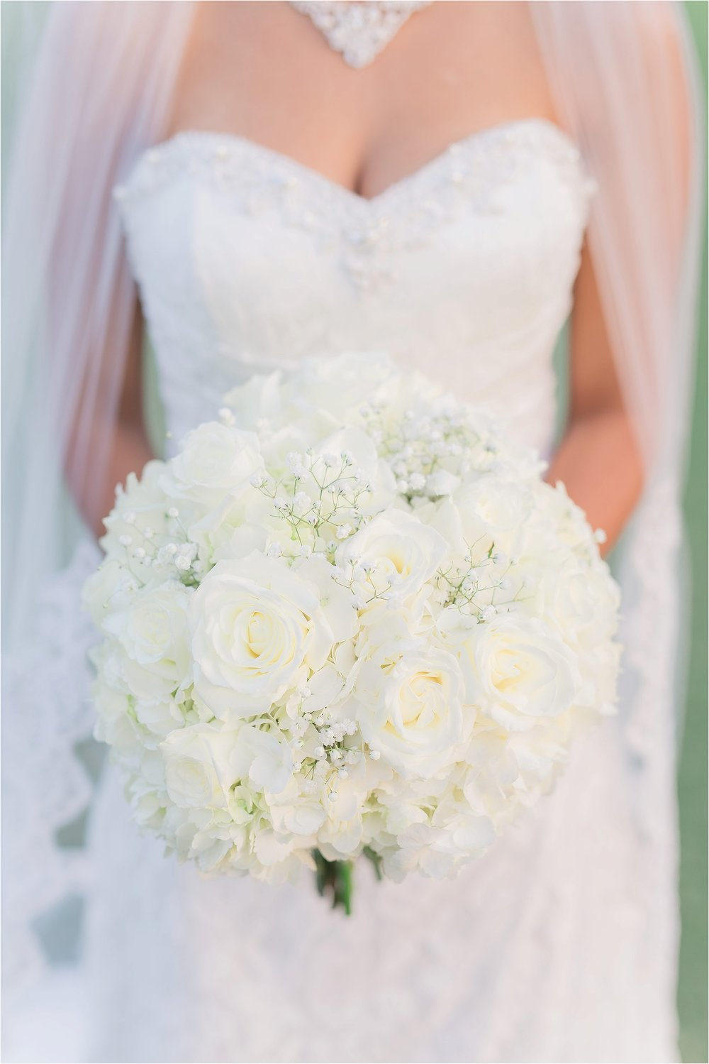 Bridal Portrait of Details of All White Bouquet with Cathedral Length Veil