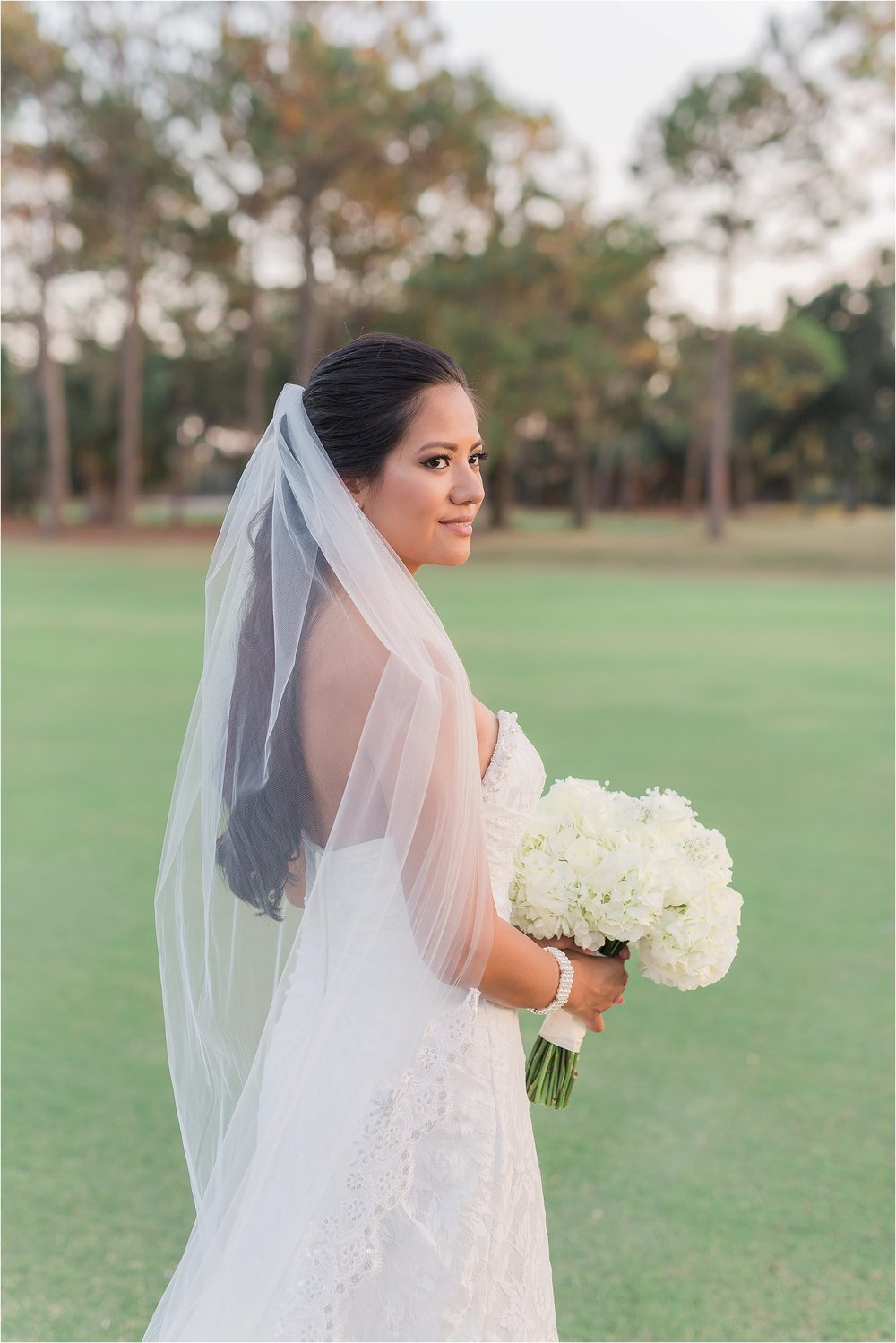 Bridal Portrait with All White Rose Bouquet and Cathedral Length Veil.