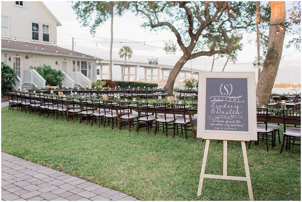 Long Farmhouse Tables at Night Swan Inn Wedding - New Smyrna