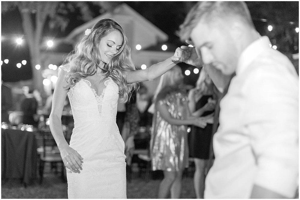 Bride and Groom Dancing under the twinkle lights Night Swan Inn