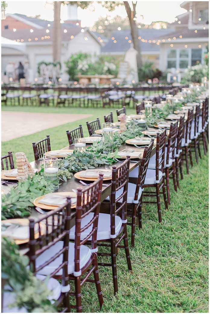 Long Farmhouse Tables at Outdoor Wedding Reception at Night Swan Inn