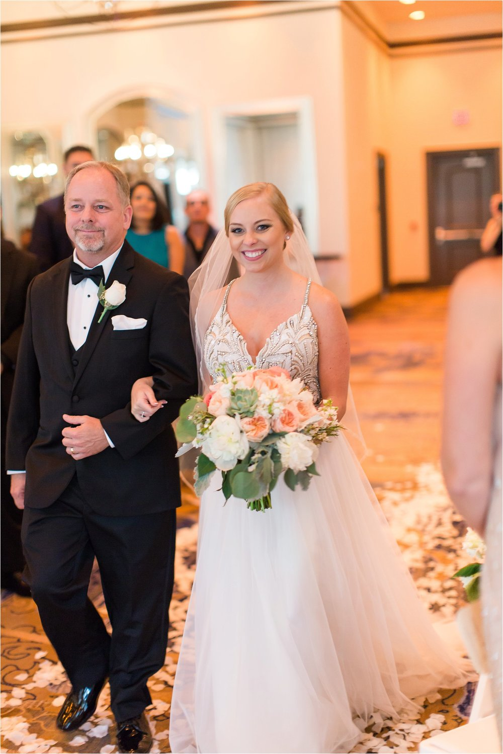 Bride walking down the aisle at Wyndham Grand Resort at Bonnet Creek Wedding by PSJ Photography