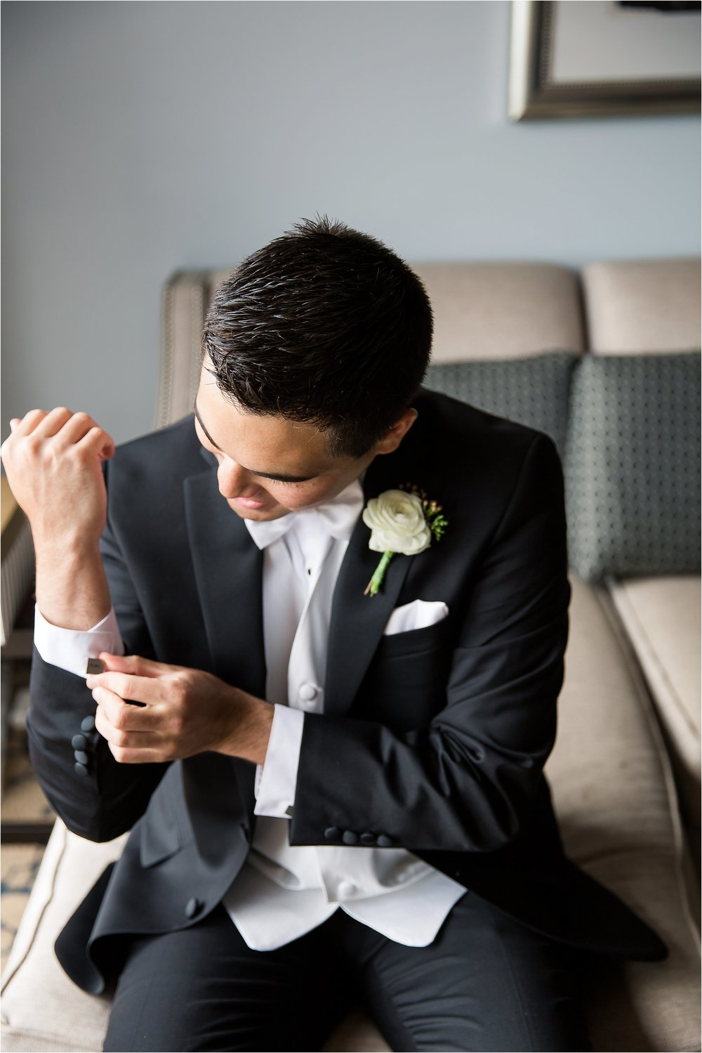Groom Portraits in classic tux with white vest and bowtie getting ready moments at Bonnet Creek Wedding by PSJ Photography