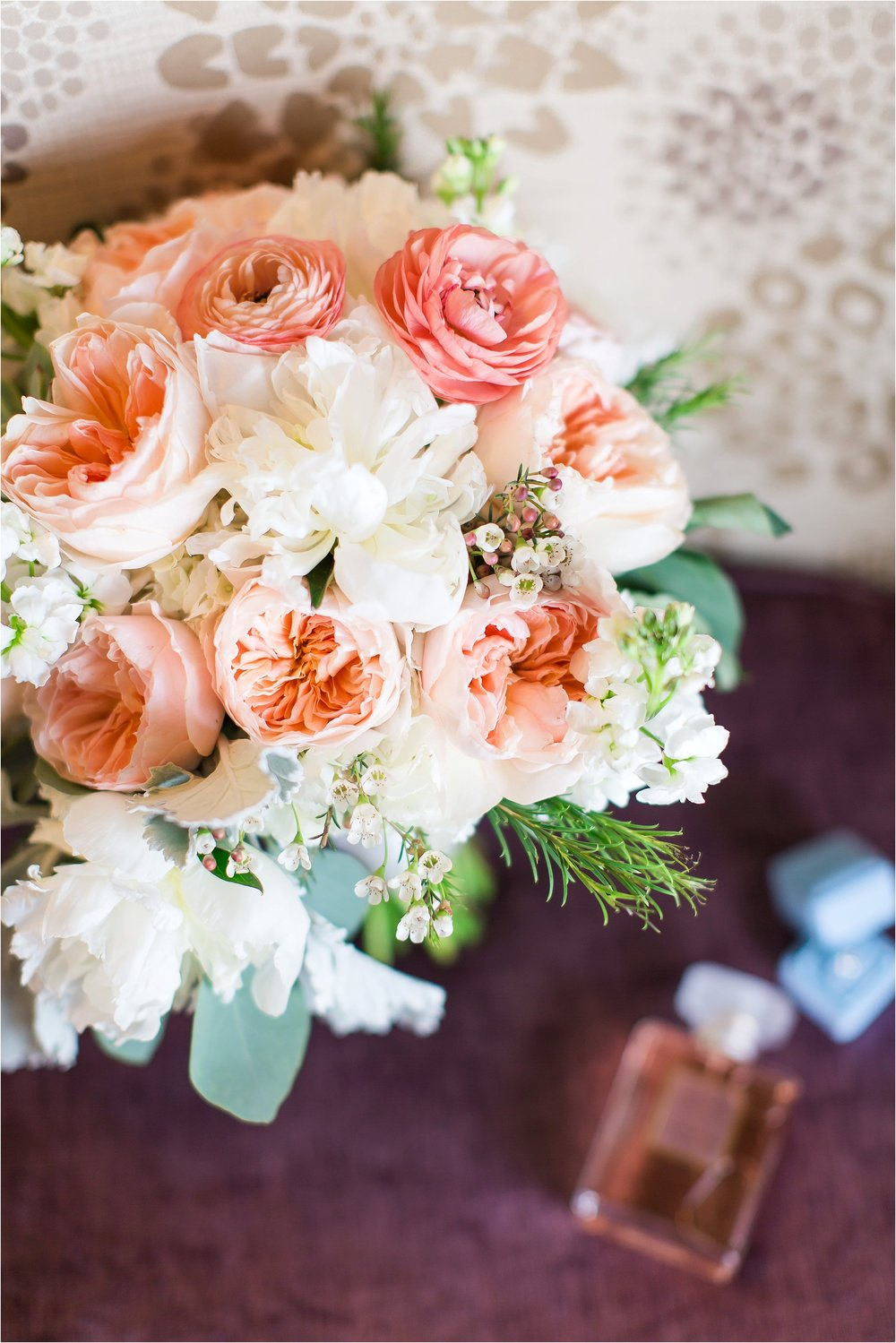 Peach garden rose and white peony bridal bouquet with ranunculus at Wyndham Grand Resort at Bonnet Creek wedding