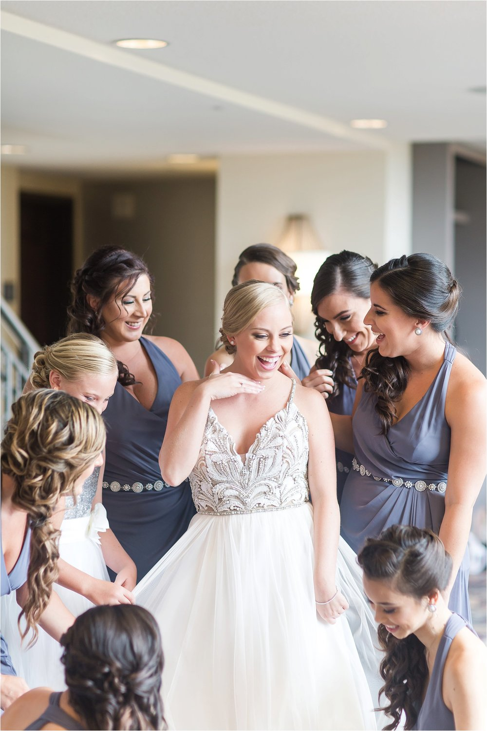 Bridesmaids getting ready in grey Chanel Mademoiselle Hayley Paige wedding gown getting ready moments at Bonnet Creek Wedding by PSJ Photography