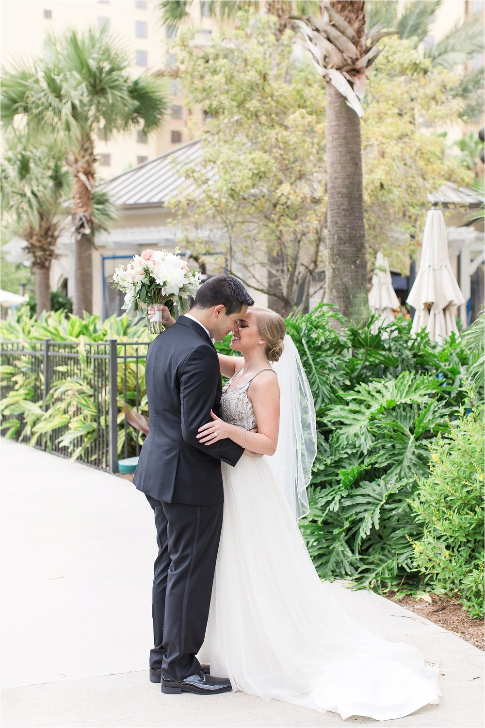 Bride and Groom at Spring time Wyndham Grand Resort at Bonnet Creek Wedding