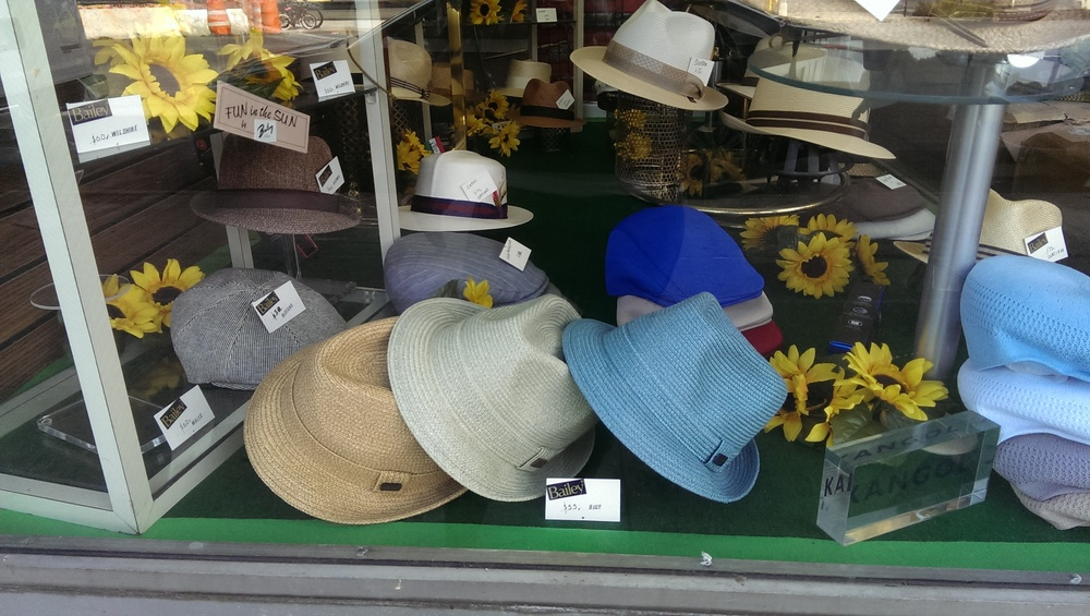 Bencraft Hatters window at their shop under the Willamsburg Bridge.  http://www.bencrafthats.com/