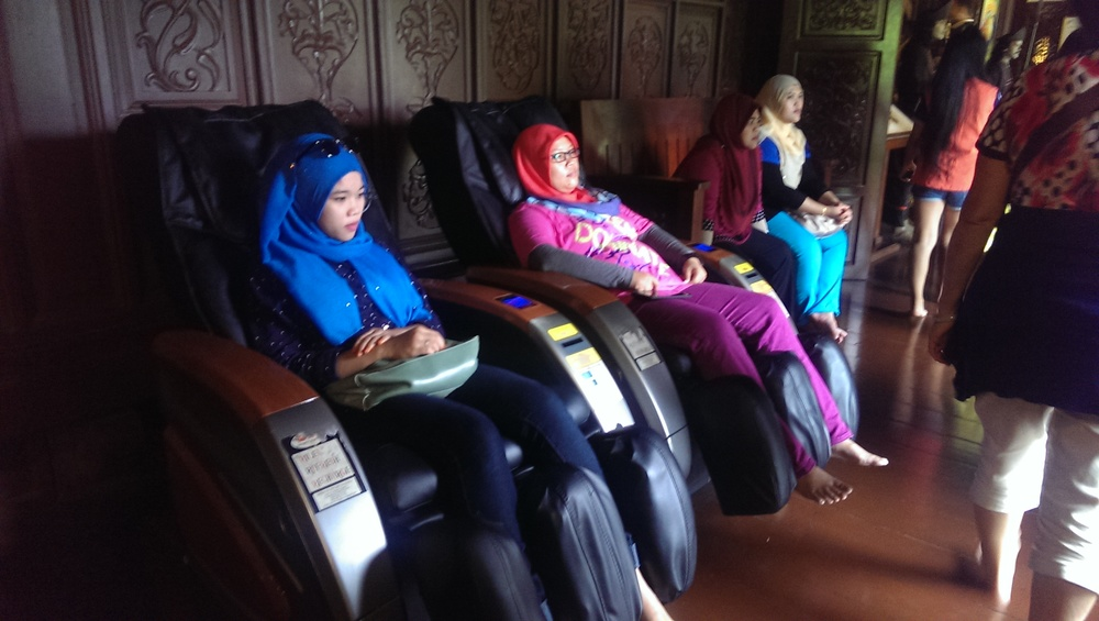 local tourists taking advantage of the complimentary massage chairs.