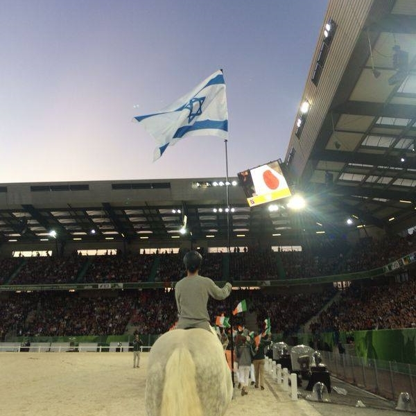 Raising the flag at the opening ceremonies of the 2014 World Equestrian Games in France