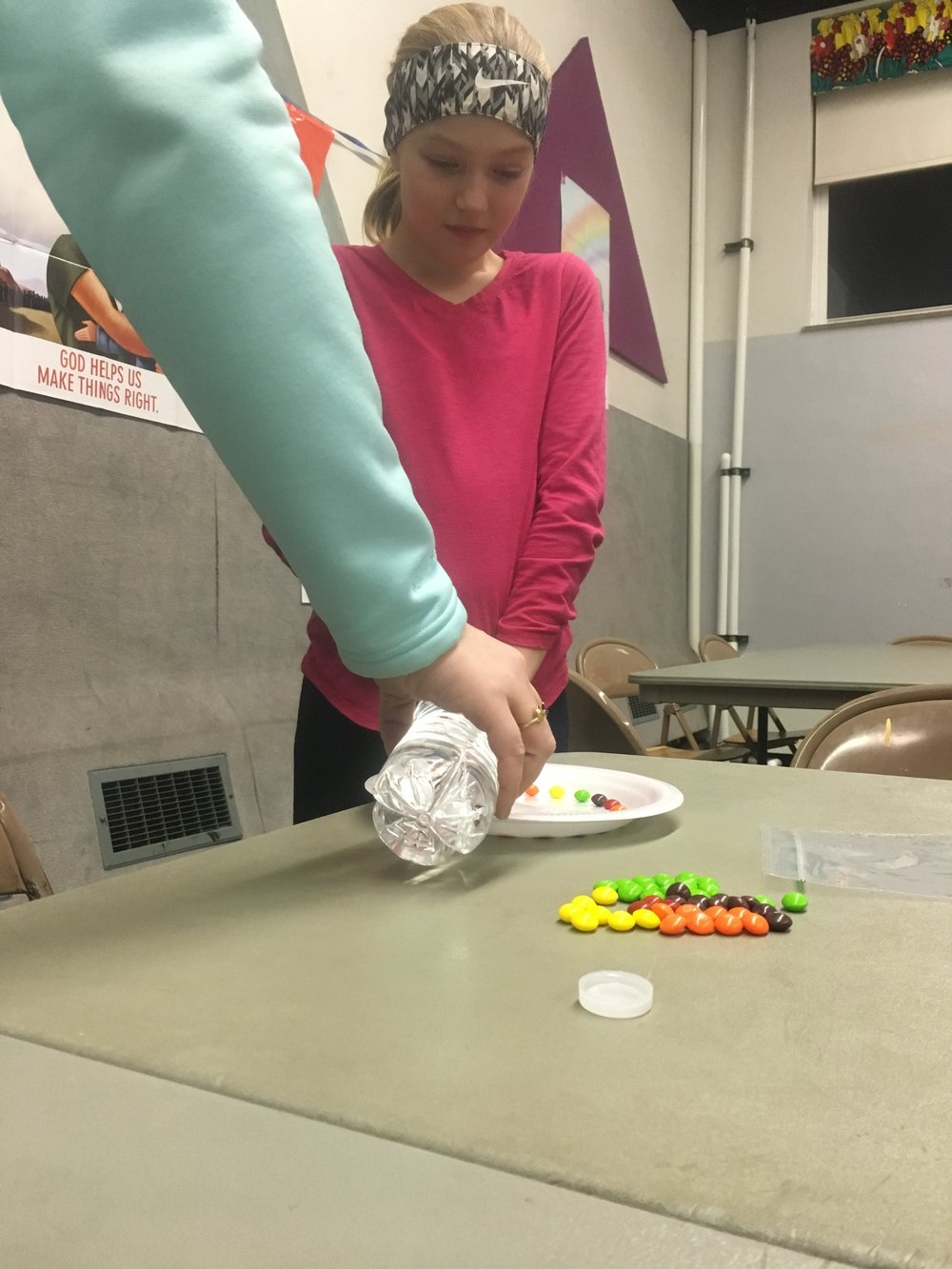 We then poured water in the center of the plate until it went halfway up the skittles.